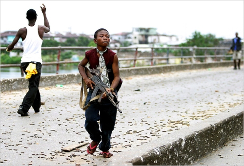 child-soldier-empty-road
