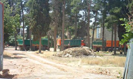 Trucks line up to demolish the Bahá'í cemetery in Shiraz, Iran.