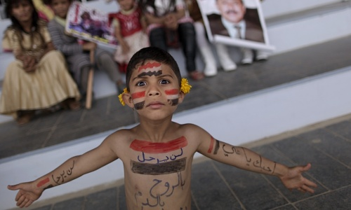 A Yemeni boy painted with the colours of his national flag. Photograph: Muhammed Muheisen/AP