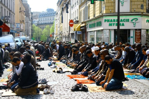 Myrha Street is part of the Arab/African immigrant quarter of Paris and is barricaded on Fridays to allow Muslims to pray in the street