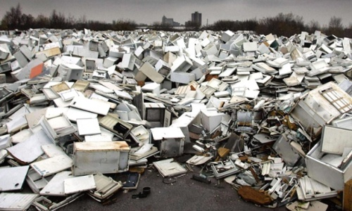 A fridge dump in Manchester. Almost two-thirds of global e-waste was made up of discarded kitchen and laundry devices. Photograph: Phil Noble/PA
