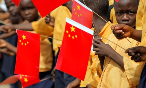 Liberian children with Chinese flags welcome a visit to Monrovia by China's president, Hu Jintao. Photograph: Christopher Herwig/Reuters/Corbis